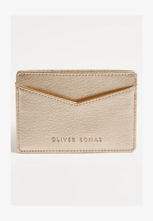 Business card holder - gold