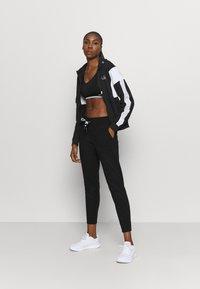 Fila - LAIN - Zip-up hoodie - black - 1
