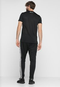 adidas Performance - TIRO AEROREADY CLIMACOOL FOOTBALL PANTS - Tracksuit bottoms - black/white - 2