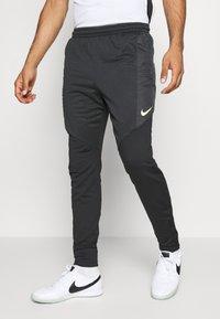 Nike Performance - DRY STRIKE WINTERIZED - Tracksuit bottoms - black/volt - 0