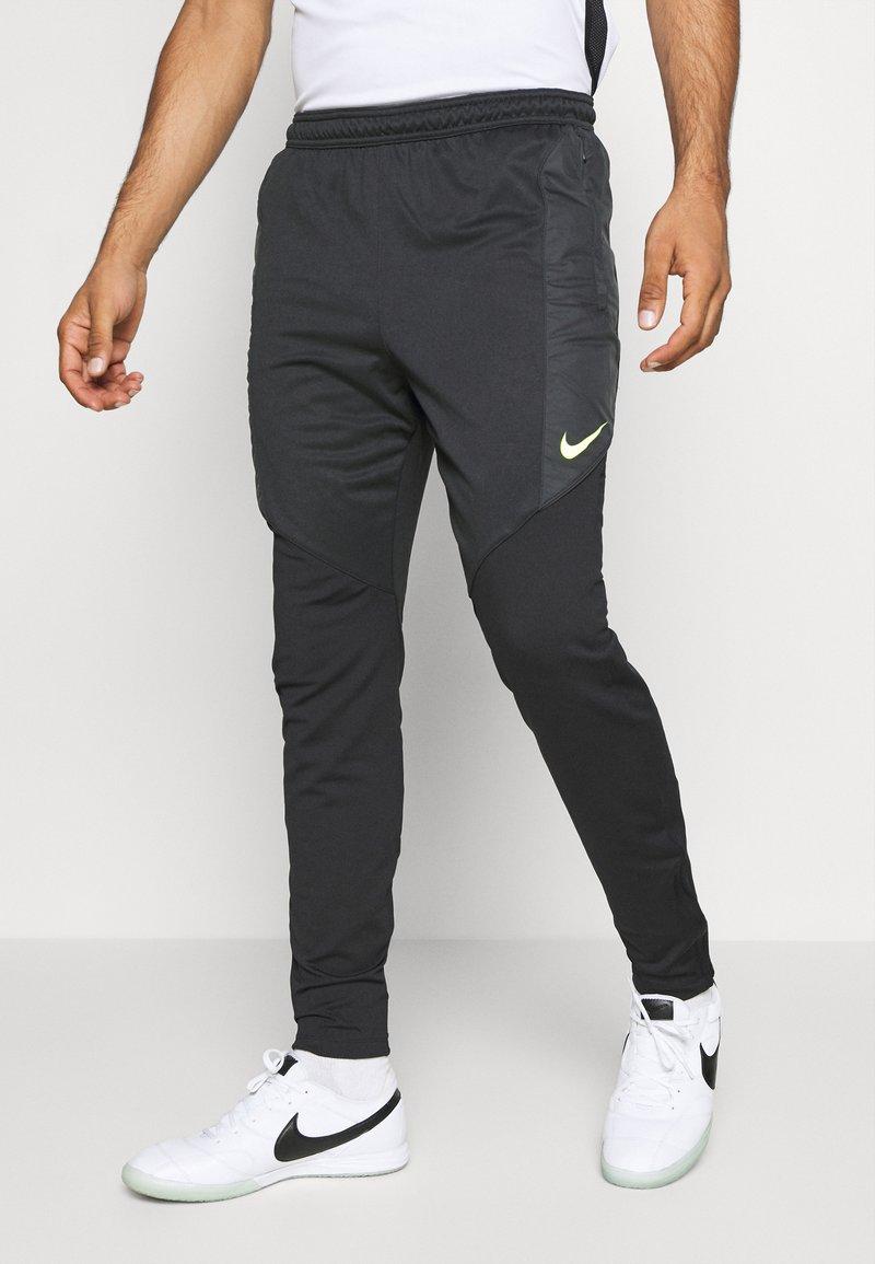 Nike Performance - DRY STRIKE WINTERIZED - Tracksuit bottoms - black/volt