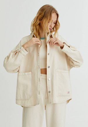 Denim jacket - mottled beige