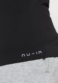 NU-IN - SHORT SLEEVE TRAINING  - Basic T-shirt - black - 5