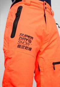 Superdry - PRO RACER RESCUE PANT - Täckbyxor - hazard orange - 4