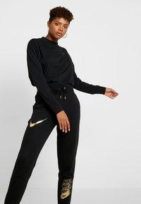 Nike Sportswear - SHINE - Tracksuit bottoms - black/metallic - 4