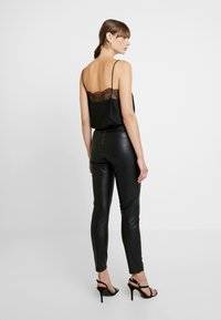 ONLY - ONLSIA PANT - Trousers - black - 2
