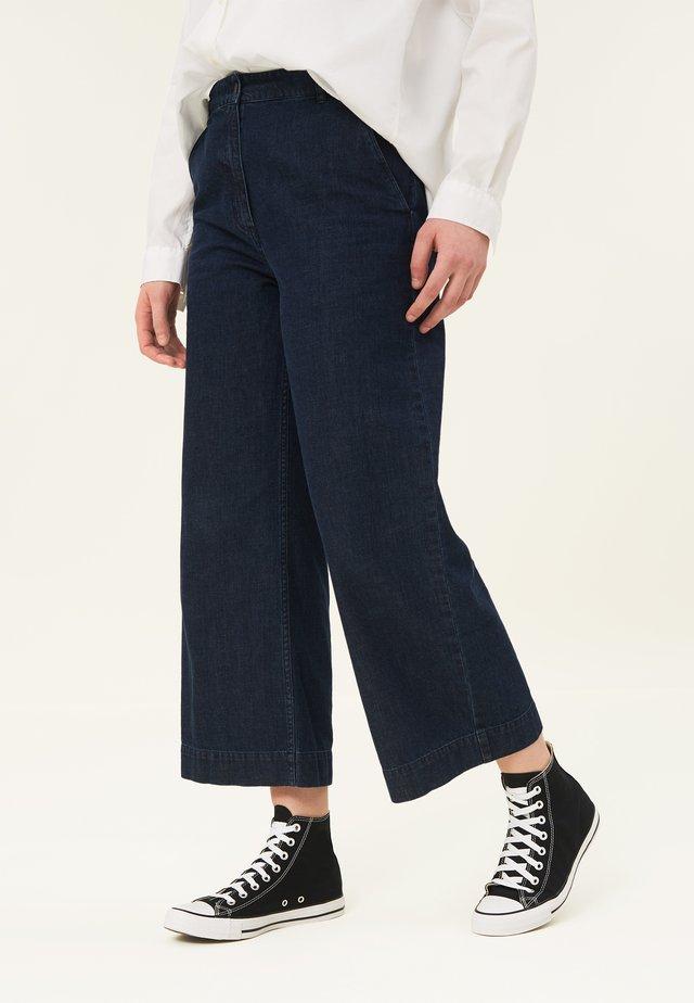 LINA  - Flared jeans - medium blue denim