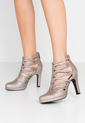 High heeled ankle boots - space glam