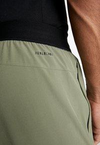 adidas Performance - CITY BASE DESIGNED4TRAINING SPORT PANTS - Pantaloni sportivi - green - 5