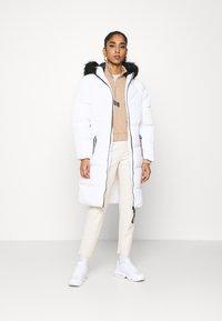 ONLY - ONLMONICA LONG PUFFER COAT  - Winter coat - bright white - 1