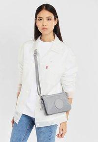 Kipling - RIRI - Across body bag - natural grey - 1