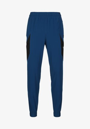 UA FUTURES WOVEN PANT - Tracksuit bottoms - graphite blue/black/white