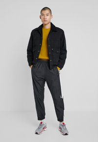 Nike SB - SHIELD - Tracksuit bottoms - black/white - 1
