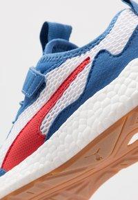 Puma - NRGY NEKO SKIM AC PS - Neutral running shoes - white/high risk red/bright cobalt - 2