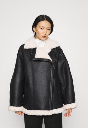 JAQUELINE - Leather jacket - black