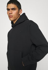 adidas Originals - HOODY UNISEX - Sweatshirt - black - 3