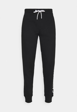 VERTICAL LOGO PANT - Tracksuit bottoms - black