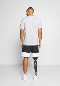 Nike Performance - TEE ATHLETE - Camiseta estampada - white/university red - 2