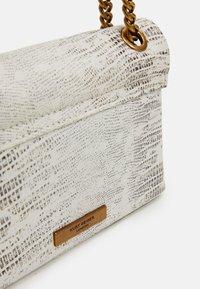 Kurt Geiger London - MINI KENSINGTON X BAG - Across body bag - white - 3