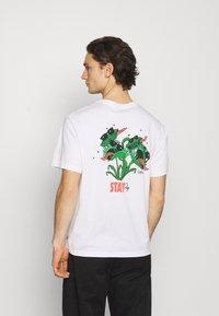 Levi's® - TEE UNISEX - T-shirt imprimé - white - 0