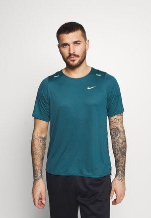 T-shirt sportiva - dark teal green/ghost green