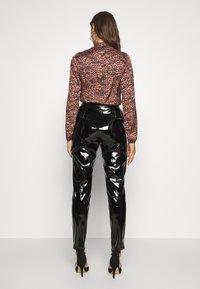 NA-KD - PATENT PANTS - Trousers - black - 2