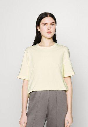TRISH - T-shirt basique - light yellow
