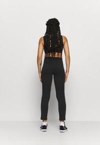 ONLY Play - ONPNYLAH SLIM PANTS - Tracksuit bottoms - black/white - 2