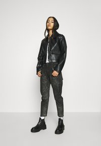 Diesel - D-FAYZA-SP2 - Relaxed fit jeans - washed black - 1
