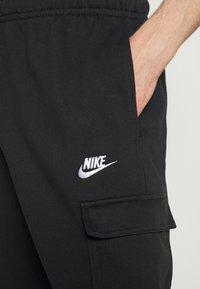 Nike Sportswear - CLUB PANT - Teplákové kalhoty - black/white - 6