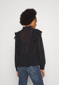 Vero Moda - VMIRIS FRILL  - Button-down blouse - black - 2