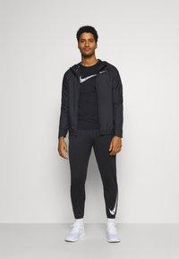 Nike Performance - ESSENTIAL PANT - Pantaloni sportivi - black/reflective silver - 1
