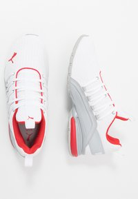 Puma - AXELION BLOCK - Sports shoes - white/high risk red - 1