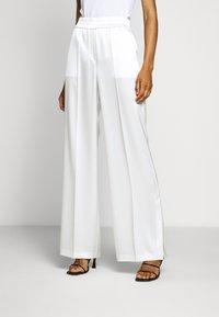 HUGO - HANIAS - Trousers - natural - 0
