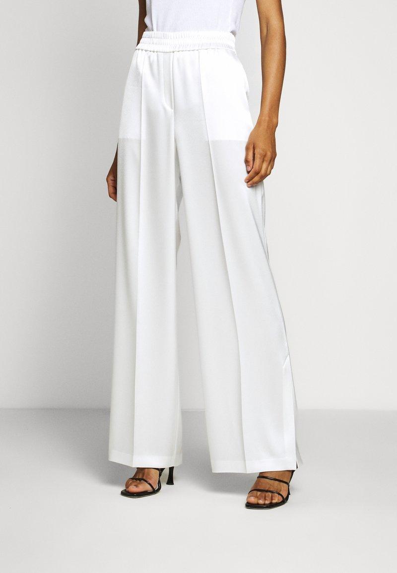 HUGO - HANIAS - Trousers - natural