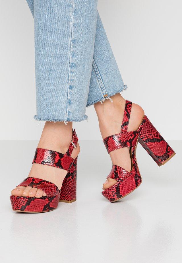 Korolliset sandaalit - rosso