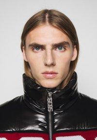 GCDS - LOGO MIX PUFFER - Winter jacket - black - 7