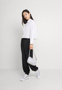 Nike Sportswear - TREND PANT - Tracksuit bottoms - black - 1