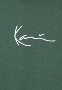 Karl Kani - UNISEX SMALL SIGNATURE HOODY  - Felpa con cappuccio - darkgreen - 6