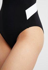 JETS Australia - LOW BACK INFINITY - Plavky - black/white - 6
