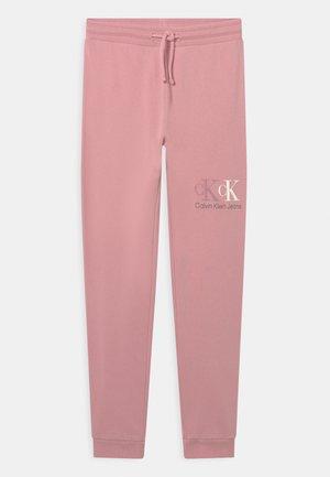 TRACK - Verryttelyhousut - light pink
