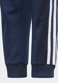 adidas Originals - ADICOLOR SST TRACK PANTS - Pantalon de survêtement - collegiate navy/white - 3