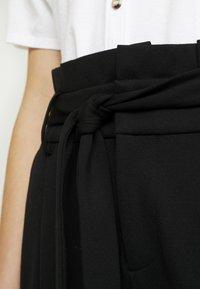 ONLY - ONLPOPTRASH EASY PAPERBAG PANT - Trousers - black - 6
