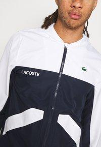 Lacoste Sport - TRACK JACKET - Verryttelytakki - white/navy blue - 4
