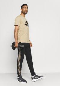 adidas Performance - CAMO - Träningsbyxor - black/white - 1