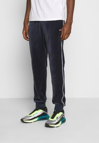 Fila - BARY - Tracksuit bottoms - black iris - 0