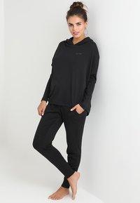 Calvin Klein Underwear - HOODIE - Pyjama top - black - 1