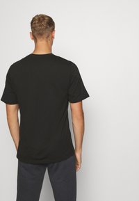 Puma - REBEL ADVANCED TEE - Print T-shirt - puma black - 2