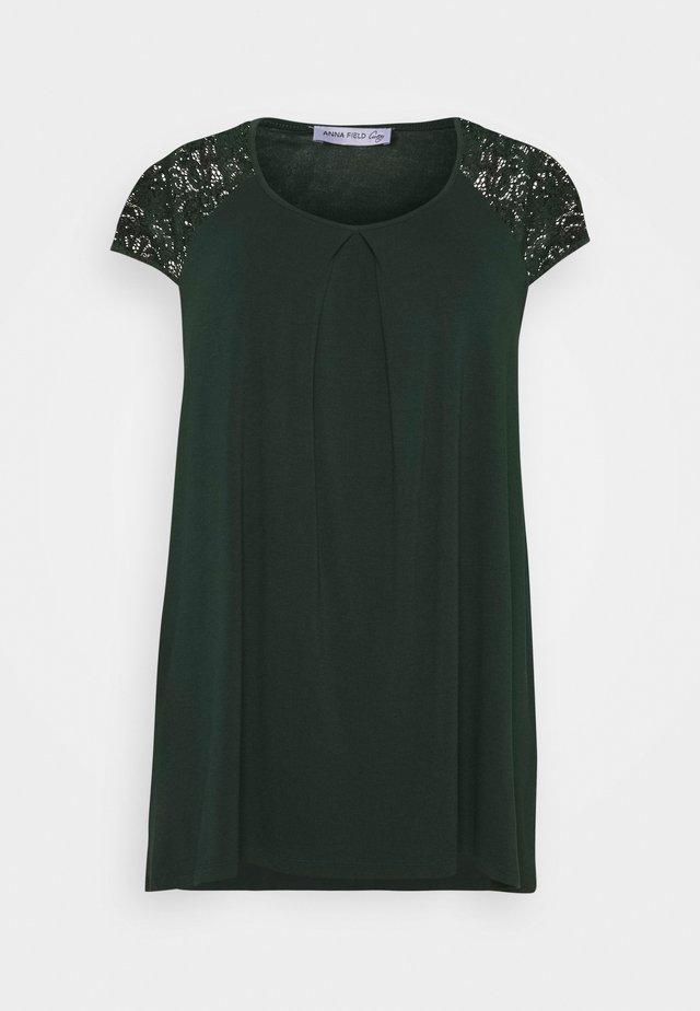 T-shirt con stampa - dark green