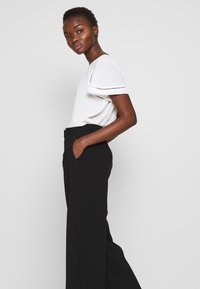 Filippa K - NAIA TROUSER - Trousers - black - 3